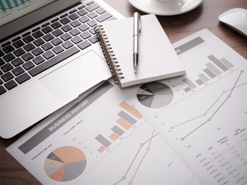 Business and financial report with laptop Accounting economic
