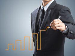 Business man drawing growth chart economic success