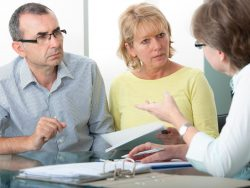 Couple getting financial retirement advice from consultant at home