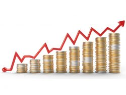 Growth red graph over golden coins stacks over white