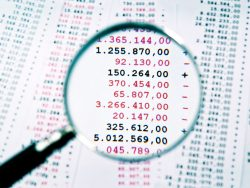 Magnifying glass focused an invoice with negative numbers
