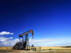 Oil well with the pump jack in action. Alberta