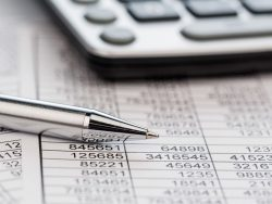 Calculator pen, balance sheet and statistics for sales and taxes