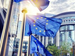 EU flags waving in front of European Parliament building. Brussels, Belgium