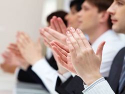 photo of business partners hands applauding