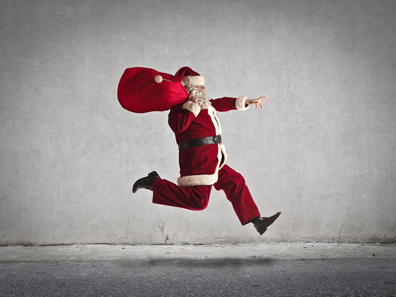 running santa with toy sack