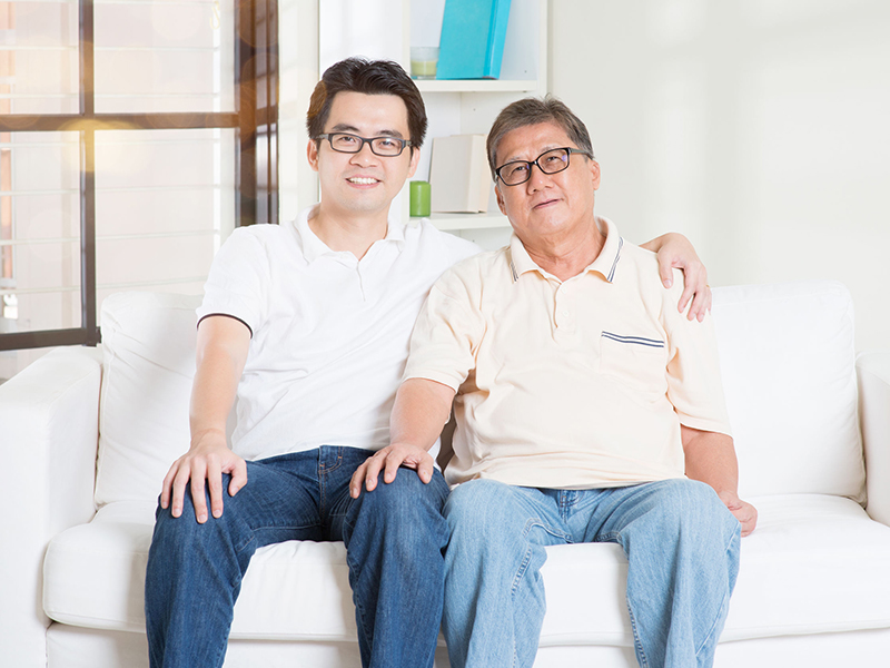 Asian senior father and adult son at home. Family living lifestyle.