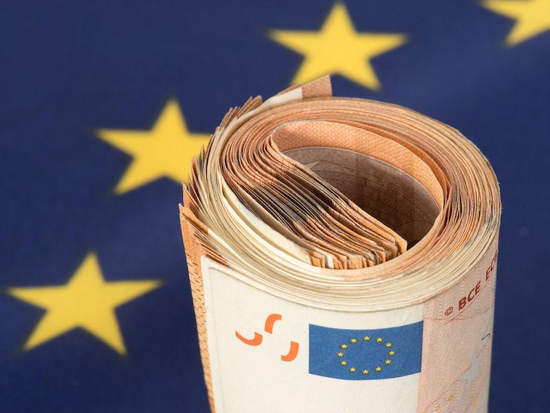 97461520 - flag of the european union eu and euro banknotes
