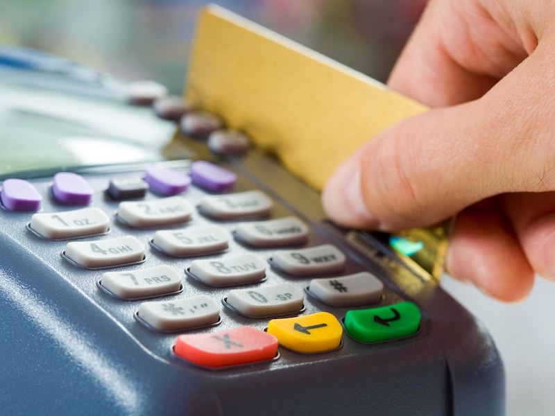 8508076 - close-up of payment machine buttons with human hand holding plastic card near by