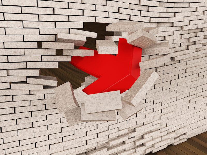 A three-dimensional composition, a red arrow, breaks through the brick wall and can be used in any design