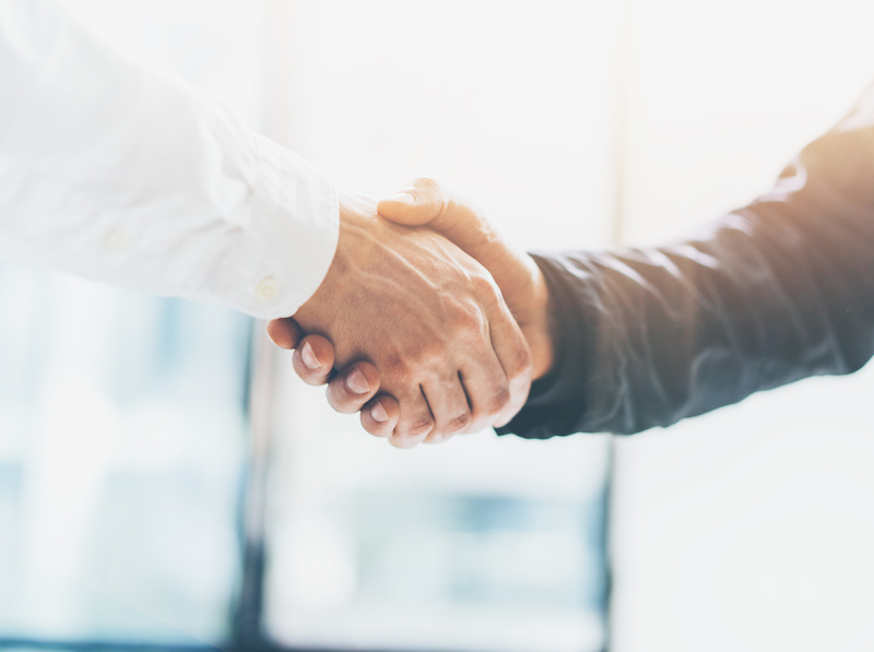 Business partnership meeting. Picture businessmans handshake. Successful businessmen handshaking after good deal. Horizontal, blurred (Business partnership meeting. Picture businessmans handshake. Successful businessmen handshaking after good deal. Ho