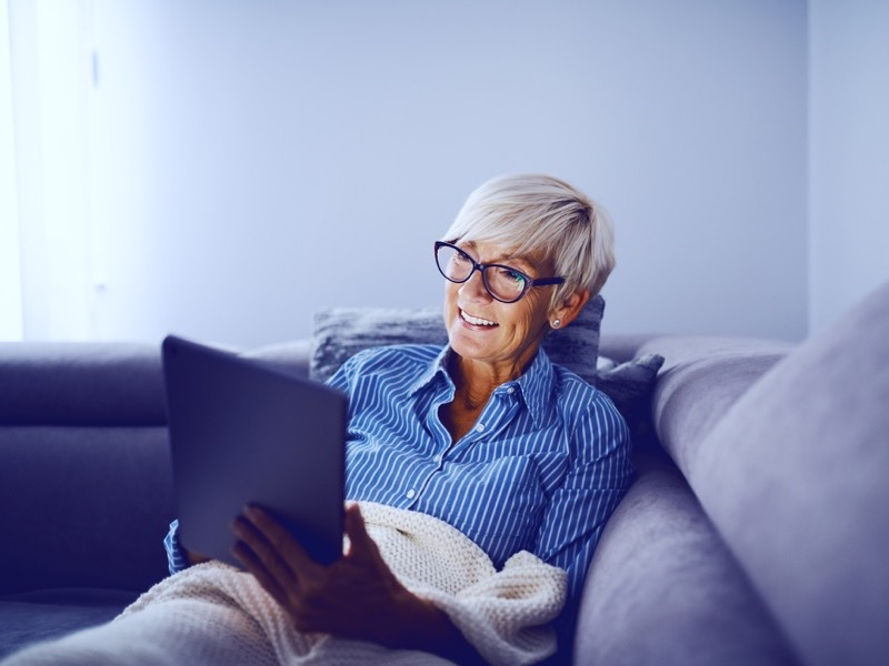 mature woman with tablet