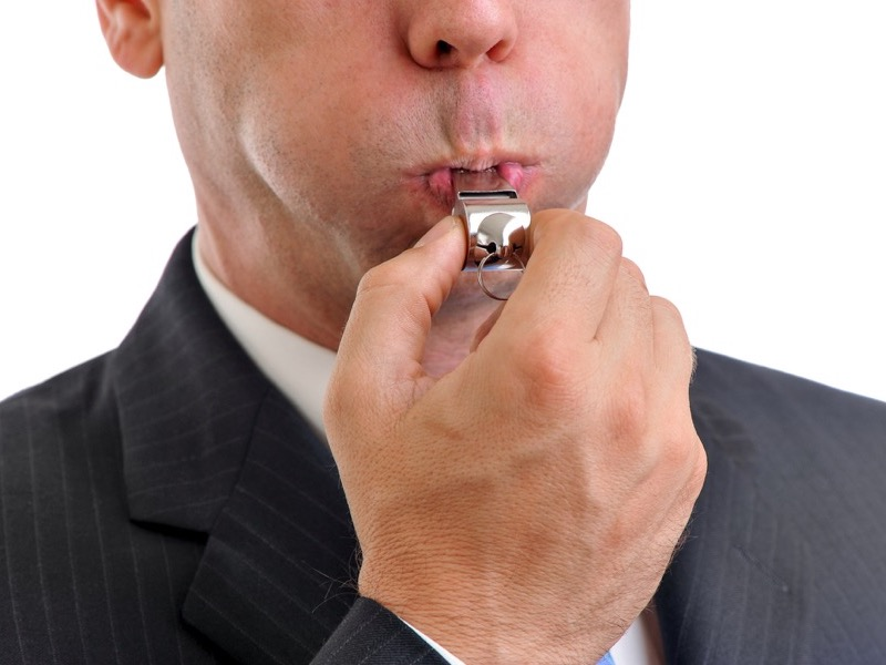 Businessman Blowing Whistle Isolated on White Background