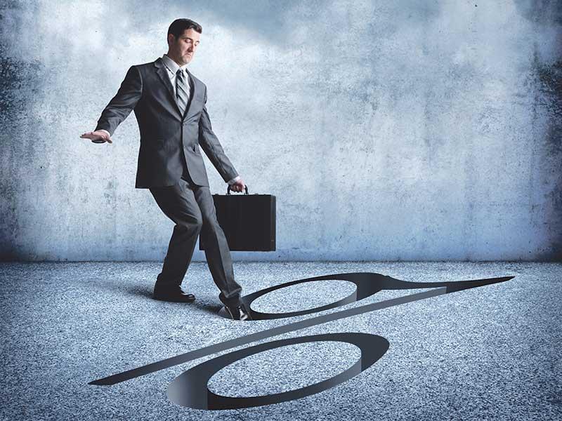 a businessman treads carefully