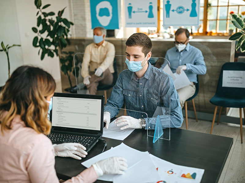 client and advisor with masks on
